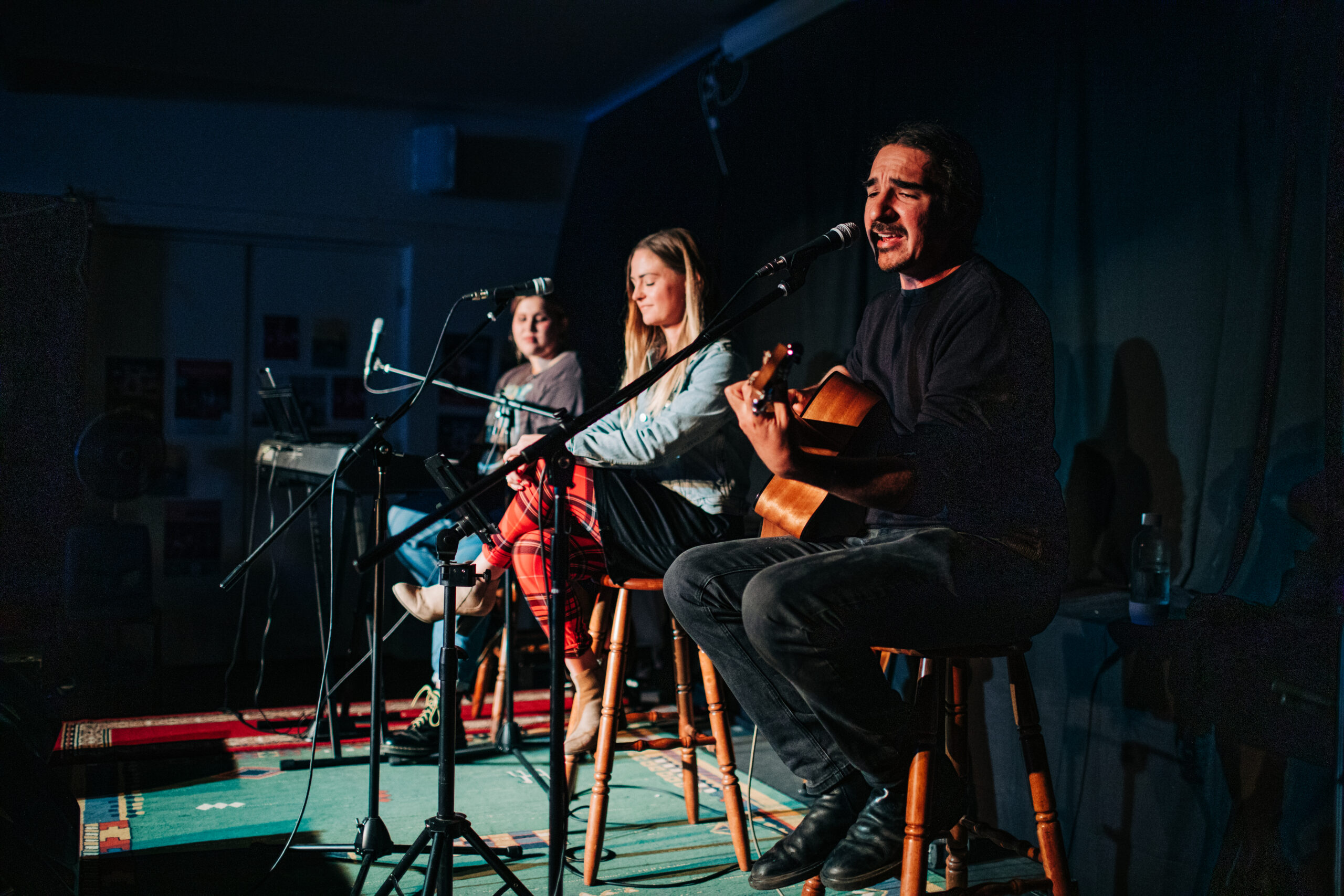 local musicians on stage for songwriters in the round at salt festival