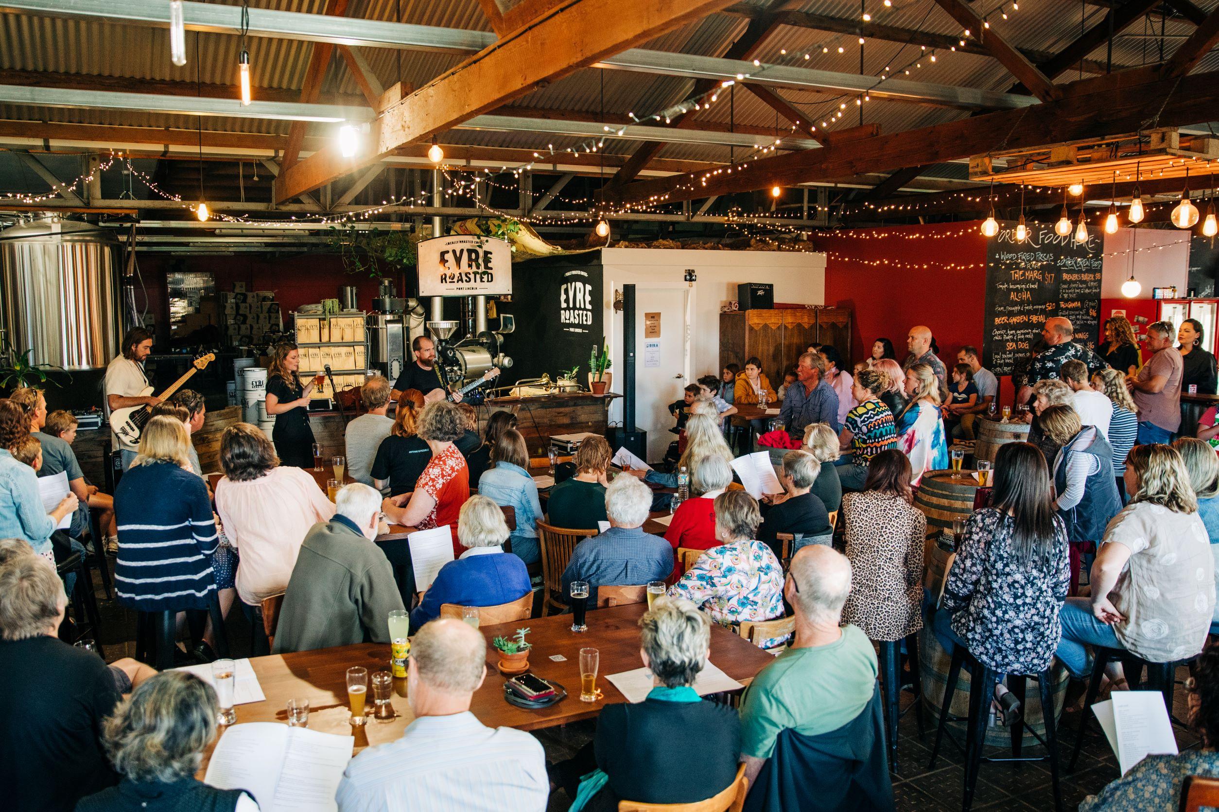 crowds at pub choir, artist lead event